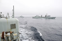 Off the coast of British Columbia, Canada. 15 May 2013 – Her Majesty's Canadian Ship (HMCS) OTTAWA follows HMCS PROTECTEUR as they sail past HMCS ALGONQUIN for a refueling at sea practice during Exercise TRIDENT FURY 13 (JOINTEX). (Photo : MCpl Patrick Blanchard, Canadian Forces Combat Camera)