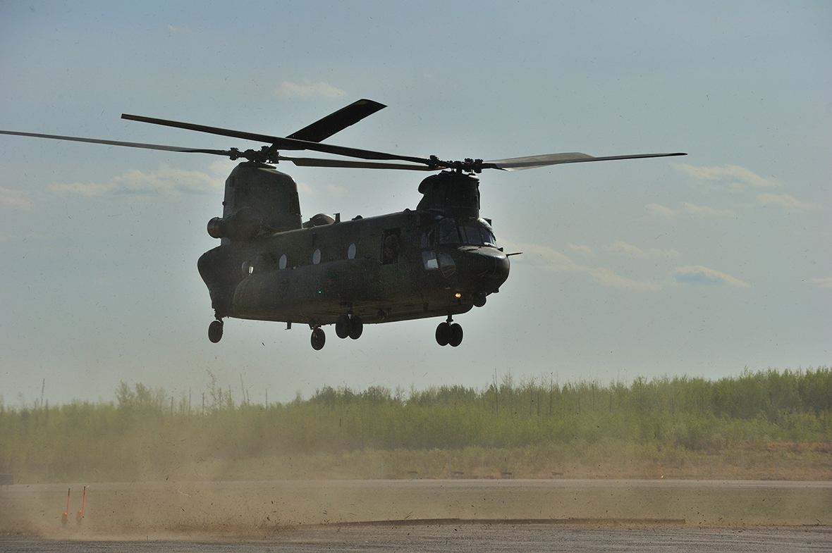 A CH-147F Chinook helicopter lands at Leismer Aerodrome in Conklin, Alberta, on May 6, 2016, as part of Canadian Armed Forces support to the Province of Alberta's emergency response to wildfires in Fort McMurray. This is the first time a CH-147F Chinook has been used in a domestic humanitarian operation. Photo: Master Corporal VanPutten, 3 CSDB Imaging
