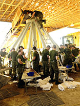 Members of 38 Canadian Brigade Group's Domestic Response Company fill sandbags at Portage la Prairie maintenance yards during Operation LENTUS on July 07, 2014. Photo: Corporal Darcy Lefebvre, Canadian Forces Combat Camera
