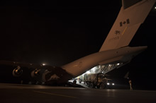 Bamako, Mali, 21 January 2013 - A truck is offloaded from a Canadian Forces CC-177 Globemaster III aircraft at the airport in Bamako, Mali. (Photo by Corporal Melissa Spencer, Canadian Forces Combat Camera)