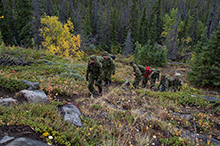August 29, 2016. Canadian Armed Forces members from 43 Fighting Troop, 12e Régiment blindé du Canada (12 RBC) and Ranger Curtis Reich, 1 Canadian Ranger Patrol Group (center) hike Paint Mountain to do a damage assessment of a communications antenna at the peak in Haines Junction, Yukon during Operation NANOOK on August 29, 2016. (Photo: Cpl Chase Miller, CFSU(O) - Imaging Services)