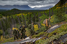 August 29, 2016. Canadian Armed Forces members from 43 Fighting Troop, 12e Régiment blindé du Canada (12 RBC) hike Paint Mountain to do a damage assessment of a communications antenna at the peak in Haines Junction, Yukon during Operation NANOOK on August 29, 2016. (Photo: Cpl Chase Miller, CFSU(O) - Imaging Services)