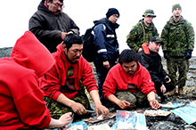 August 28, 2016. During survival skills training near Rankin Inlet, Nunavut, members of 1 Canadian Ranger Patrol Group prepare a traditional Inuit dish of muktuk for deployed members during Operation NANOOK 2016 on August 28, 2016. (Photo: Petty Officer Second Class Belinda Groves, Task Force Imagery Technician)