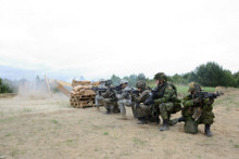 Poland. 29 May 2014 - Paratroopers from 3rd Battalion, Princess Patricia's Canadian Light Infantry, the U.S. 1-503 Airborne and the Polish 16th Airborne Battalion wait for the C4 to detonate before they can advance on an obstacle during training at the Czertyn Engineer Training Center in Poland. (photo by Sgt Bern LeBlanc, Canadian Army Public Affairs)