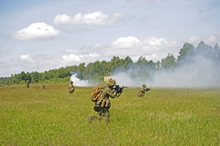 Drawkso, Pomorskie, Poland. 9 June 2014 - The 5 Platoon assault team advance on their objective during Exercise SABER STRIKE at the Drawsko Pomorskie training area in Poland on June 9, 2014. (photo by Sgt Bern LeBlanc, Canadian Army Public Affairs)