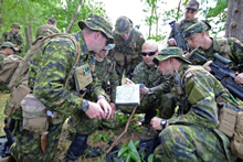 Oleszno training area, Poland. 15 June 2014 - Warrant Officer Hegland of 3rd Battalion, Princess Patricia's Canadian Light Infantry instructs his soldiers on map reading during navigation training in the Oleszno training area of Poland during Exercise SABER STRIKE. (Photo by Sgt Bern LeBlanc, Canadian Army Public Affairs)