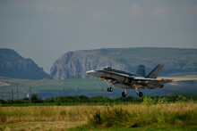 Câmpia Turzii, Romania. 19 June 2014 - A CF-18 Hornet takes off for training operations with the iconic Cheile Tuzii in the background on June 19, 2014 in Câmpia Turzii, Romania during Operation REASSURANCE. (Photo: LS Alex Roy, 3 Wing Imaging)
