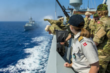 Mediterranean Sea, 12 June 2014 – Danish sailors on the upper decks of Her Danish Majesty's Ship ESBERN SNARE observe Her Majesty's Canadian Ship REGINA sailing past. (Photo by Cpl Michael Bastien, MARPAC Imaging Services)
