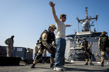 Mediterranean Sea. 17 June 2014 - Her Majesty's Canadian Ship REGINA's naval boarding party conducts a mock boarding on USS Taylor (FFG-50) in the Mediterranean Sea during Operation REASURANCE. (Photo: Cpl Michael Bastien, MARPAC Imaging Services)