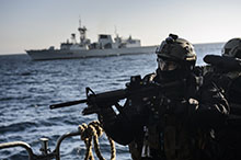 Northern Atlantic Ocean. 2 October 2015 – A member of the Enhanced Naval Boarding Party from Her Majesty's Canadian Ship WINNIPEG boards Portuguese flagship, NPR DON FRANCISCO DE ALMEIDA while conducting Standing NATO Maritime Group One training in the Northern Atlantic Ocean on Operation REASSURANCE. (Photo: Cpl Stuart MacNeil, HMCS WINNIPEG)