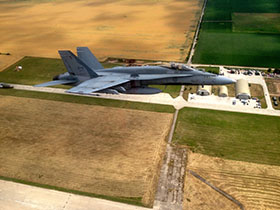 Câmpia Turzii, Romania. 27 June 2014 – A CF-188 Hornet flies over Câmpia Turzii, Romania on June 27, 2014 during Operation REASSURANCE. (Photo: LS Alex Roy, 3 Wing Imaging)