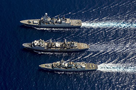 Near Crete, Greece. 27 June 2014 – Her Majesty's Canadian Ship REGINA (bottom) and Her Majesty's Ship Diamond D43 (foreground) conduct a replenishment at sea with FS MARNE A630 on June 27, 2014 near Crete, Greece during Operation REASSURANCE. (Photo: Cpl Michael Bastien, MARPAC Imaging Services)