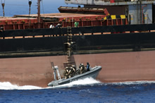 Mediterranean Sea. 25 July 2015 – The Enhanced Naval Boarding Party from Her Majesty's Canadian Ship WINNIPEG approach a merchant vessel in the Mediterranean Sea to conduct a maritime situational awareness approach to inform the crew about Operation ACTIVE ENDEAVOUR on July 25, 2015. (Photo: Cpl Stuart MacNeil, HMCS WINNIPEG)