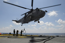 Mediterranean Sea. 15 August 2015 – The CH-124 Sea King helicopter air detachment from Her Majesty's Canadian Ship WINNIPEG connect a fueling hose to the aircraft during a Helicopter In-Flight Refuelling in the Mediterranean Sea on August 15, 2015 during Operation REASSURANCE. (Photo: Cpl Stuart MacNeil, HMCS WINNIPEG)