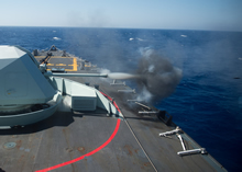 Mediterranean Sea. 24 August 2014 - Her Majesty's Canadian Ship TORONTO fires the 57mm gun at a training target in the Mediterranean Sea during Operation REASSURANCE. (Photo: MS Peter Reed, Formation Imaging Services Halifax)