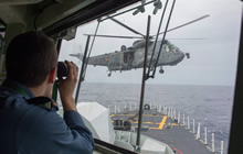 Mediterranean Sea. 2 December 2014 - Her Majesty's Canadian Ship (HMCS) Toronto's CH-124 Sea King helicopter conducts passenger transfers as the starboard lookout keeps an eye on the horizon during Operation REASSURANCE. (Photo: Maritime Task Force - OP Reassurance, DND)