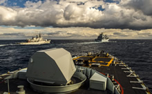Her Majesty's Canadian Ship (HMCS) FREDERICTON performs replenishment at sea approaches with ITS LIBECCIO (left) and FGS BONN (right) during Operation REASSURANCE on January 19, 2016. (Photo: Corporal Anthony Chand, Formation Imagery Services)