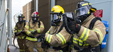 16 March 2016. Crewmembers dressed in full firefighting gear prepare to attack a simulated fire during a ship exercise, as Her Majesty's Canadian Ship (HMCS) FREDERICTON patrols the area between the Lamna Channel, Greece and Turkey during Operation REASSURANCE on March 16, 2016. (Photo: LS Dan Bard, Formation Imaging Services)