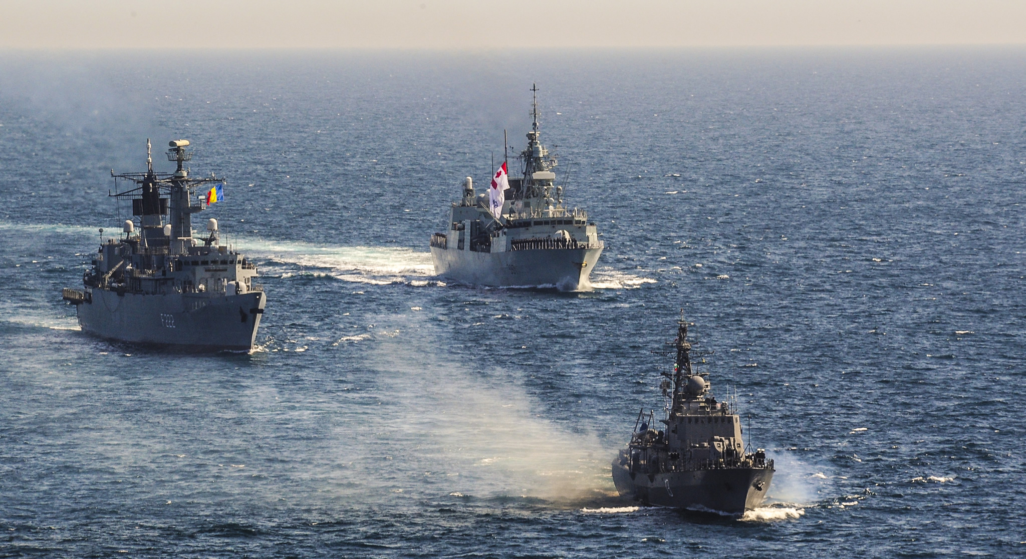 Black Sea. 5 April 2016 – Her Majesty's Canadian Ship (HMCS) FREDERICTON performs a PASEX with the Bulgarian Frigate, BGS RESHITELNI (F13) and the Romanian Frigate, ROS REGINA MARIA, during a patrol in the Black Sea during Operation Reassurance. (Photo: Master Corporal Sebastian Allain, HMCS FREDERICTON Air Detachment)