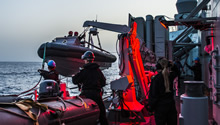 May 10 2016. Members of Her Majesty's Canadian Ship (HMCS) FREDERICTON launch the rigid hull inflatable boat (RHIB) during a night time personnel exchange during Operation REASSURANCE, May 10, 2016. (Photo: Corporal Anthony Chand, Formation Imagery Services)