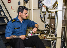 June 7 2016. Leading Seaman Dion March onboard Her Majesty's Canadian Ship (HMCS) FREDERICTON takes an air sample from the tank refill station during Operation REASSURANCE, June 7, 2016. (Photo: Corporal Anthony Chand, Formation Imaging Services)