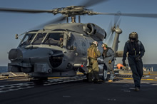 13 January 2015 – A United States Navy SH-60 Seahawk helicopter lands on the flight deck of Her Majesty's Canadian Ship FREDERICTON to conduct interoperability training during Operation REASSURANCE on January 13, 2015. (Photo: Maritime Task Force - OP Reassurance, DND)