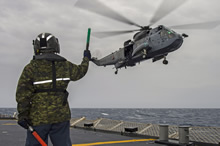 22 February 2015 - Her Majesty's Canadian Ship FREDERICTON's CH-124 Sea King helicopter conducts hoisting exercises with the ship's naval boarding party during Operation REASSURANCE. (Photo: Maritime Task Force - OP Reassurance, DND)