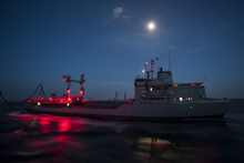 2 March 2015 – Her Majesty's Canadian Ship FREDERICTON conducts a liquid replenishment at sea at night with German supply ship FGS SPESSART during Operation REASSURANCE. (Photo: Maritime Task Force - OP Reassurance, DND)