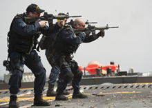25 March 2015 - Her Majesty's Canadian Ship FREDERICTON's Naval Boarding Party conducts small arms training on the flight deck during Operation REASSURANCE. (Photo: Maritime Task Force - OP REASSURANCE, DND)