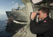 18 April 2015 - A starboard lookout aboard Her Majesty's Canadian Ship FREDERICTON keeps a close watch for hazards during an underway replenishment with USNS MEDGAR EVERS on Exercise JOINT WARRIOR as part of their deployment under Operation REASSURANCE. (Photo: Maritime Task Force - OP Reassurance, DND)