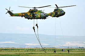 Campia Turzii, Romania. 18 July 2014 - Romanian Army troops rappel from two IAR-330 Puma helicopters during a joint training exercise between the Canadian Air Task Force Romania and the Romanian Air Force (RoAF) on July 18, 2014 in preparation for the RoAF tactical exercise and evaluation in Campia Turzii, Romania during Operation REASSURANCE. (Photo: Capt Christopher Daniel, ATF 1401 PAO )