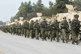 Germany. 19 October 2014 – Members of Oscar Company Group, 3rd Battalion, the Royal Canadian Regiment walk to the HEAT Trainer to practice rollover drills during Exercise COMBINED RESOLVE III in Germany on October 19, 2014. (Photo: Corporal Dolores Crampton, Directorate of Army Public Affairs)