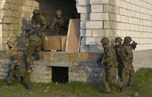 Central and Eastern Europe. 29 November 2014 - Members of the Polish army conduct urban operations with members of Oscar Company Group, 3rd Battalion, The Royal Canadian Regiment during Operation REASSURANCE. (Photo: Land Task Force - OP Reassurance, DND)