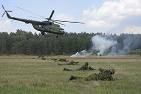 Eastern Europe. 17 July 2014 - MI-8 HIP transport helicopter flies over a line of soldiers from 3rd Battalion, Royal Canadian Regiment, Mike company while taking part in a multi-national fire power demonstration with the Polish 6th Airborne Brigade and American 173rd Airborne Brigade during Operation REASSURANCE on July 17, 2014 in Eastern Europe. (Photo: Cpl Mark Schombs, 4 Cdn Div, Petawawa)