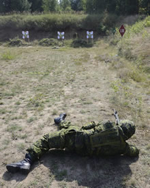 Eastern Europe. 7 August 2014 – A Canadian soldier lies on his side as part of improvised shooting positions range training as soldiers from Mike Company, 3rd Battalion, The Royal Canadian Regiment participate in the annual Polish Individual Battle Task Standards (IBTS) during Operation REASSURANCE. (Photo by Lt J-F Carpentier, 2 CMBG PAO)