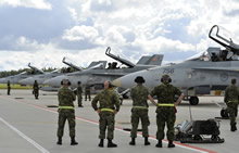 Šiauliai, Lithuania. 26 August 2014 – Canadian Armed Forces Maintainers, from the Canadian Air Task Force Lithuania, await the pilots to disembark the CF-188's to greet them and prepare the aircraft for the coming mission during Operation REASSURANCE, in support of NATO Baltic Air Policing, Block 36. (Photo: Cpl Kenneth Galbraith, CFJIC/Combat Camera)