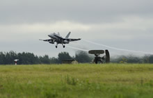 Šiauliai Air Base, Lithuania. 27 August 2014 - A CF-188 Hornet takes-off from Šiauliai Air Base during Operation REASSURANCE, in support of NATO Baltic Air Policing Block 36. (Photo: Cpl Kenneth Galbraith, CFJIC/Combat Camera)