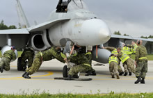 Šiauliai Air Base, Lithuania. 27 August 2014 - Royal Air Force and Royal Canadian Air Force maintainers relocate a CF-188 Hornet during Operation REASSURANCE, in support of NATO Baltic Air Policing Block 36. (Photo: Cpl Kenneth Galbraith, CFJIC/Combat Camera)