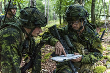 Hohenfels, Germany. 20 August 2015. Major Simon Côté, Land Task Force Commander, briefs Lieutenant Neil Gasser on attack positions while conducting an evening reconnaissance mission during Exercise ALLIED SPIRIT II at the Joint Multinational Readiness Center in during Operation REASSURANCE (Photo: Corporal Nathan Moulton, Land Task Force Imagery).