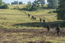 Hohenfels, Germany. 21 August 2015. Canadian Armed Forces members advance to a designated helicopter landing area during Exercise ALLIED SPIRIT II at the Joint Multinational Readiness Center during Operation REASSURANCE (Photo: Corporal Nathan Moulton, Land Task Force Imagery).