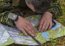 Kadaga, Latvia. 25 September 2015. Sergeant Martin Roy, 3R22eR uses navigation equipment during Exercise SILVER ARROW at Adazi Military Training Area in Kadaga, Latvia during Operation REASSURANCE (Photo: Corporal Nathan Moulton, Land Task Force Imagery, OP REASSURANCE).