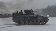 Hohenfels, Germany. 15 January 2016 – Canadian Armed Forces members ride in a German Army Marder 1, infantry fighting vehicle during Exercise ALLIED SPIRIT IV at the Joint Multinational Readiness Center Training area in Hohenfels, Germany during Operation REASSURANCE. (Photo: Corporal Nathan Moulton, Land Task Force Imagery, OP REASSURANCE)