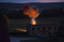 Wędrzyn, Poland. 10 June 2016. Smoke from a simulated explosion rises above a building during an urban-combat scenario involving Canadian and American soldiers as part of Exercise ANAKONDA-16, a multinational military exercise involving 23 nations, in Wȩdrzyn, Poland the evening of June 10, 2016. The Canadian soldiers are deployed to Central and Eastern Europe as part of the Operation REASSURANCE Land Task Force to support regional NATO assurance measures and enhance interoperability with NATO allies. (Photo: Master Corporal Andrew Davis, Operation REASSURANCE Land Task Force Imagery Technician)