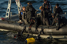 Atlantic Ocean. October 6, 2016 – Divers from Her Majesty's Canadian Ship (HMCS) Charlottetown get ready to climb into the ship's Rigid Hull Inflatable Boat (RHIB) after a hull inspection dive in the Atlantic Ocean off the coast of Scotland during OP REASSURANCE. (Photo: Cpl Blaine Sewell, Formation Imagery Services)