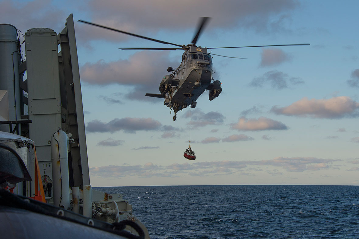 Atlantic Ocean. October 12, 2016 – Her Majesty's Canadian Ship (HMCS) CHARLOTTETOWN's CH-124 Sea King helicopter crew conducts hoist training during Exericse JOINT WARRIOR. (Photo: Cpl Blaine Sewell, Formation Imaging Services)