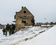 Poland. 5 February 2015 - Members of 3rd Battalion, The Royal Canadian Regiment (3 RCR) practice urban operational tactics during a simulated house clearing mission with the Polish Army from 7th Battalion 25 Air Calvary, located at Wedrzyn's training base in Poland as part of Operation REASSURANCE. (Photo: Land Task Force - OP Reassurance, DND)