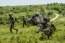 Cincu, Romania. 19 May 2015 - Members of 3rd Battalion, The Royal Canadian Regiment react to an ambush during Exercise SARMIS 15 in Cincu, Romania on May 19, 2015 during Operation REASSURANCE. (Photo: Land Task Force - OP Reassurance, DND)