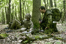 Cincu, Romania. 30 May 2015 - A British signaler links up with Major Mark Lee, Land Task Force Commander during Exercise SARMIS 15 in Cincu, Romania on May 30, 2015 during Operation REASSURANCE. (Photo: Corporal Precious Carandang, 8 Wing Trenton)
