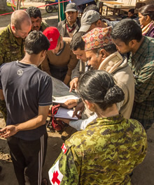 Members of the Disaster Assistance Response Team (DART) discusses with local officials during a reconnaissance patrol in the framework of assistance to earthquake victims in Nepal by Government of Canada, 2 May 2015 Photo: Sgt Yannick Bédard, Canadian Forces Combat Camera