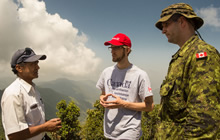 Risk Steenweg, a representative from the Department of Foreign Affairs, Trade and Development Canada (DFATD), along with Major Frank Gould, member of the Disaster Assistance Response Team (DART) speaks with a village representative during a reconnaissance patrol in the context of assistance to earthquake victims in Nepal by the Government of Canada, 2 May 2015. Photo: Sgt Yannick Bédard, Canadian Forces Combat Camera